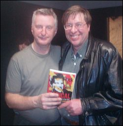 Billy Bragg, author Chuck Laszewski with book